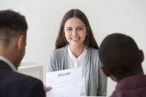 recruiting team reading resume