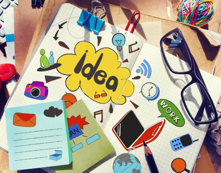 Designer's Table with Notes about Ideas and Tools
