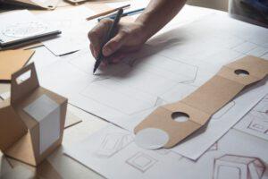 Designer sketching drawing design - LightHouse Graphics